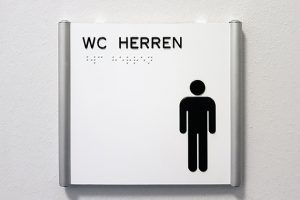 WC-Schild mit Piktogramm und taktiler Beschriftung